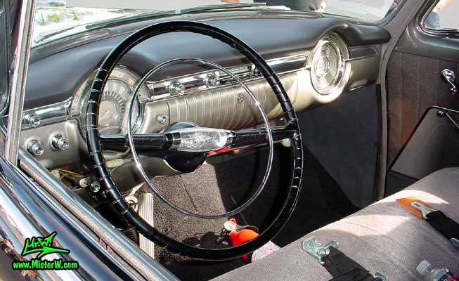 Photo of a black 1953 Oldsmobile 88 2 Door Hardtop Coupe at the Scottsdale Pavilions Classic Car Show in Arizona. 1953 Oldsmobile Odometer & Dashboard
