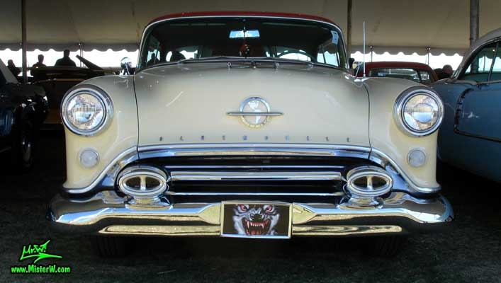 Photo of a white 1954 Oldsmobile 2 Door Hardtop Coupe at a Classic Car Auction in Scottsdale, Arizona. 1954 Oldsmobile Frontview