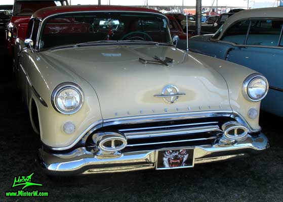Photo of a white 1954 Oldsmobile 2 Door Hardtop Coupe at a Classic Car Auction in Scottsdale, Arizona. White 1954 Oldsmobile