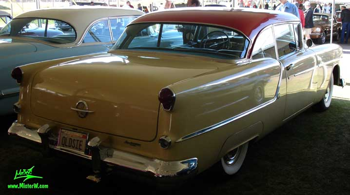 Photo of a white 1954 Oldsmobile 2 Door Hardtop Coupe at a Classic Car Auction in Scottsdale, Arizona. 1954 Oldsmobile Sideview