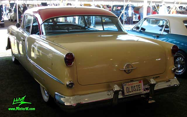 Photo of a white 1954 Oldsmobile 2 Door Hardtop Coupe at a Classic Car Auction in Scottsdale, Arizona. 1954 Oldsmobile Rearview