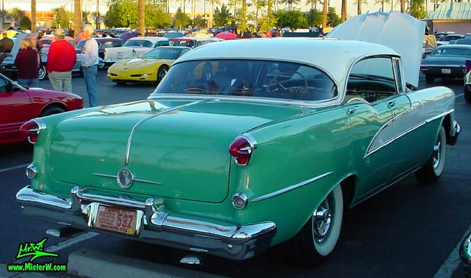 Photo of a white & turkquoise 1955 Oldsmobile 4 Door Hardtop Sedan at the Scottsdale Pavilions Classic Car Show in Arizona. 1955 Oldsmobile Tail Lights