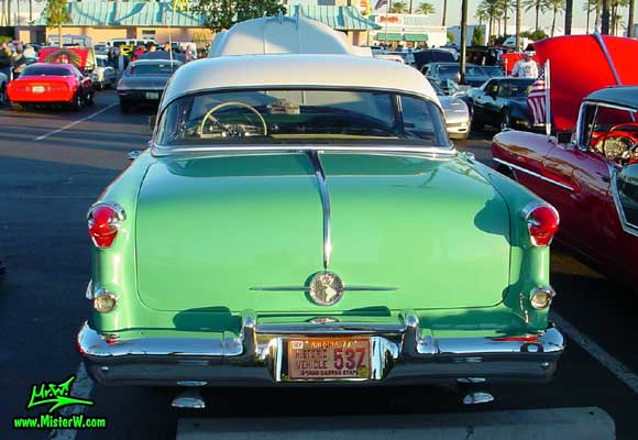 Photo of a white & turkquoise 1955 Oldsmobile 4 Door Hardtop Sedan at the Scottsdale Pavilions Classic Car Show in Arizona. 1955 Oldsmobile Rearview