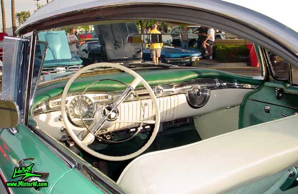 Photo of a white & turkquoise 1955 Oldsmobile 4 Door Hardtop Sedan at the Scottsdale Pavilions Classic Car Show in Arizona. 1955 Oldsmobile Odometer & Dash Board