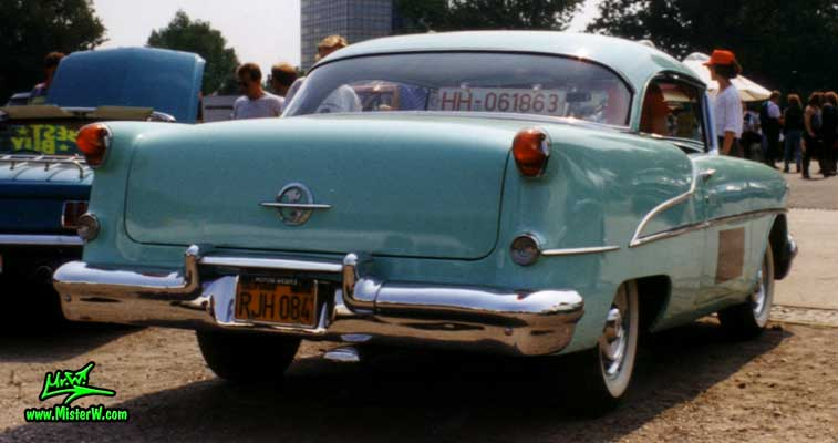 Photo of a turkquoise 1955 Oldsmobile 2 Door Hardtop Coupe at the Wheels Nationals Classic Car Meeting in Hamburg, Germany. 1955 Oldsmobile Rearview