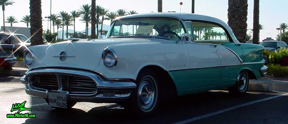 Photo of a white & turkquoise 1956 Oldsmobile 4 Door Hardtop Sedan at the Scottsdale Pavilions Classic Car Show in Arizona. 56 Olds Sedan