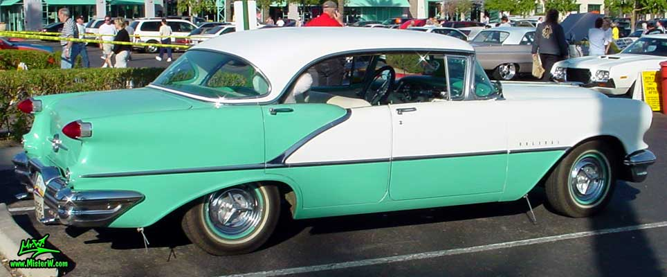 Photo of a white & turkquoise 1956 Oldsmobile 4 Door Hardtop Sedan at the Scottsdale Pavilions Classic Car Show in Arizona. 1956 Oldsmobile Sideview