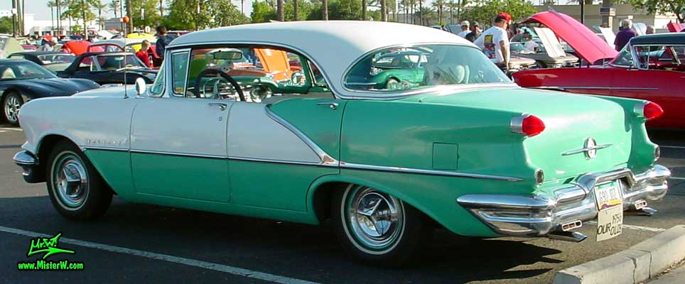 Photo of a white & turkquoise 1956 Oldsmobile 4 Door Hardtop Sedan at the Scottsdale Pavilions Classic Car Show in Arizona. 1956 Oldsmobile Fins & Tail Lights