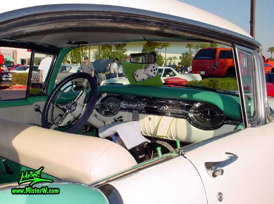 Photo of a white & turkquoise 1956 Oldsmobile 4 Door Hardtop Sedan at the Scottsdale Pavilions Classic Car Show in Arizona. 1956 Oldsmobile Dashboard & Interior