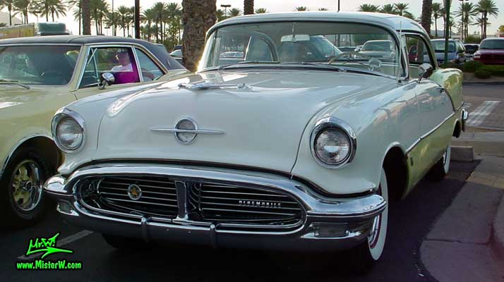 Photo of a white & yellow 1956 Oldsmobile 2 Door Hardtop Coupe at the Scottsdale Pavilions Classic Car Show in Arizona. 1956 Oldsmobile Coupe Sideview