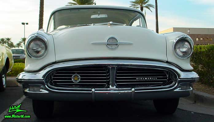 Photo of a white & yellow 1956 Oldsmobile 2 Door Hardtop Coupe at the Scottsdale Pavilions Classic Car Show in Arizona. 1956 Oldsmobile Coupe Frontview