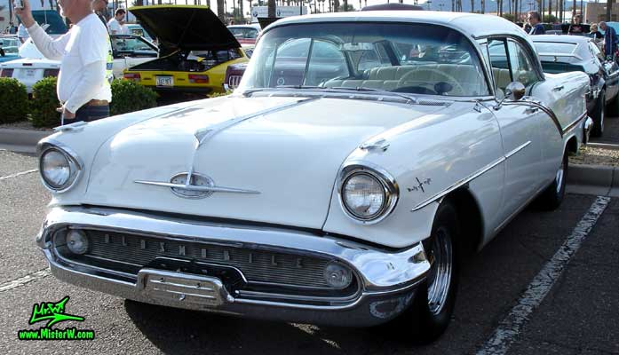 Photo of a white 1957 Oldsmobile 4 Door Hardtop Sedan at the Scottsdale Pavilions Classic Car Show in Arizona. 57 Olds Sedan