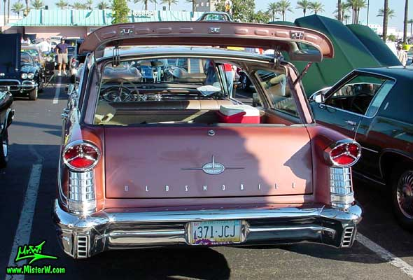 Photo of a pink 1957 Oldsmobile 4 Door Hardtop Station Wagon at the Scottsdale Pavilions Classic Car Show in Arizona. 1957 Oldsmobile Station Wagon Tail Lights