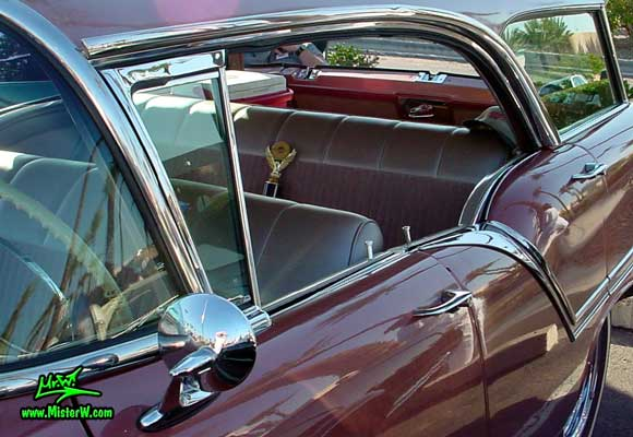 Photo of a pink 1957 Oldsmobile 4 Door Hardtop Station Wagon at the Scottsdale Pavilions Classic Car Show in Arizona. Postless 1957 Oldsmobile 4 Door Station Wagon