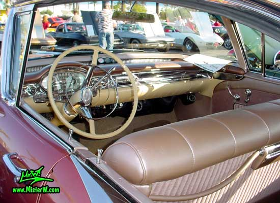 Photo of a pink 1957 Oldsmobile 4 Door Hardtop Station Wagon at the Scottsdale Pavilions Classic Car Show in Arizona. 1957 Oldsmobile Dashboard & Interior