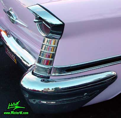 Photo of a pink 1957 Oldsmobile 2 Door Hardtop Coupe at the Scottsdale Pavilions Classic Car Show in Arizona. 1957 Oldsmobile Tail Lights