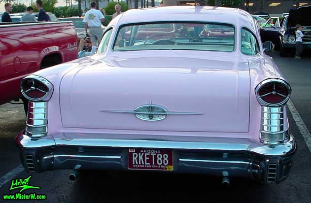 Photo of a pink 1957 Oldsmobile 2 Door Hardtop Coupe at the Scottsdale Pavilions Classic Car Show in Arizona. 1957 Oldsmobile Rearview