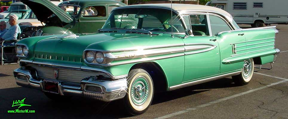 Photo of a green 1958 Oldsmobile 4 Door Hardtop Sedan at a Classic Car Meeting in Arizona. 58 Olds Ninety Eight