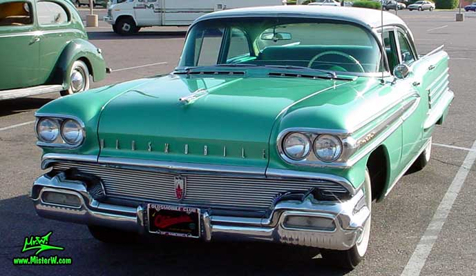 Photo of a green 1958 Oldsmobile 4 Door Hardtop Sedan at a Classic Car Meeting in Arizona. 1958 Oldsmobile 98