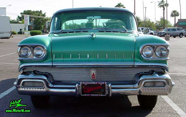 Photo of a green 1958 Oldsmobile 4 Door Hardtop Sedan at a Classic Car Meeting in Arizona. 1958 Oldsmobile 98 Frontview