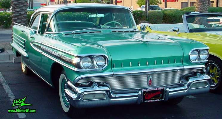 Photo of a green 1958 Oldsmobile 4 Door Hardtop Sedan at a Classic Car Meeting in Arizona. 1958 Oldsmobile 98 Chrome Grill