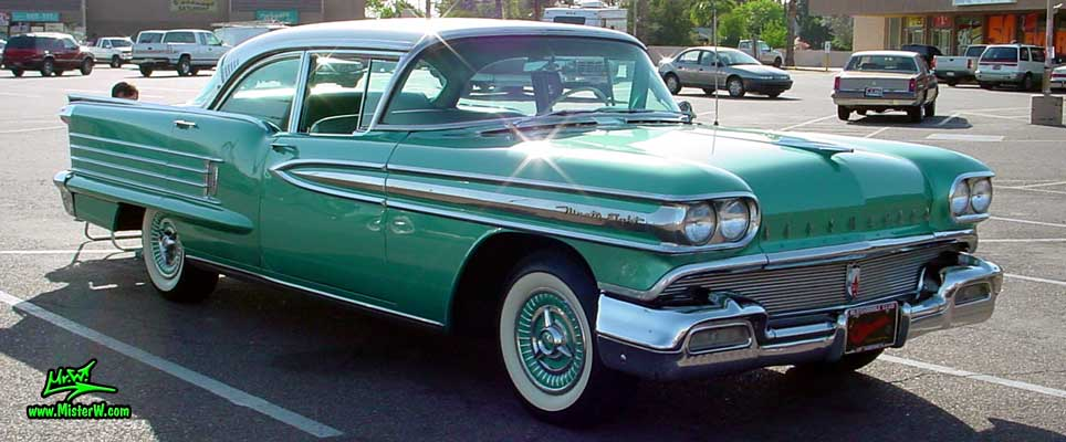 Photo of a green 1958 Oldsmobile 4 Door Hardtop Sedan at a Classic Car Meeting in Arizona. 1958 Oldsmobile 98 Sideview