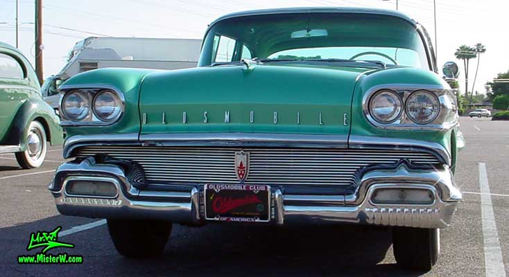 Photo of a green 1958 Oldsmobile 4 Door Hardtop Sedan at a Classic Car Meeting in Arizona. 1958 Oldsmobile 98 Front Bumper & Tons of Chrome