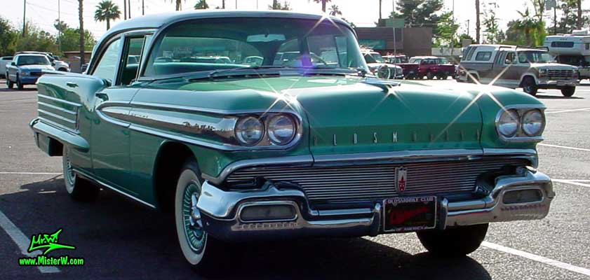 Photo of a green 1958 Oldsmobile 4 Door Hardtop Sedan at a Classic Car Meeting in Arizona. 1958 Oldsmobile Ninety Eight Sedan