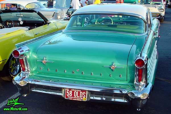 Photo of a green 1958 Oldsmobile 4 Door Hardtop Sedan at a Classic Car Meeting in Arizona. 1958 Oldsmobile 98 Rearview
