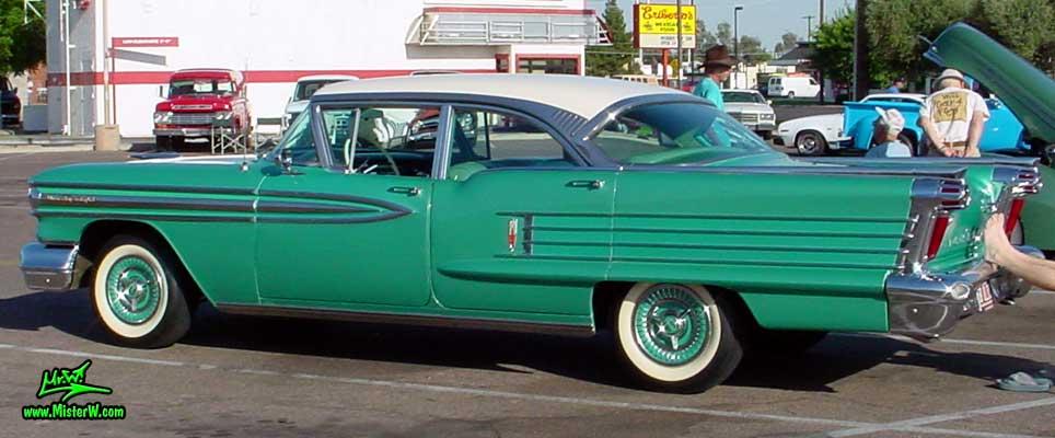 Photo of a green 1958 Oldsmobile 4 Door Hardtop Sedan at a Classic Car Meeting in Arizona. 1958 Oldsmobile Sedan Side Crome