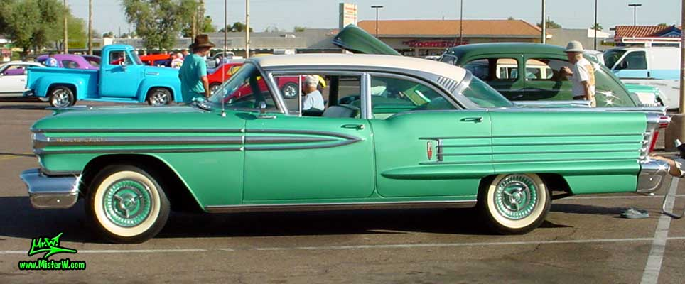 Photo of a green 1958 Oldsmobile 4 Door Hardtop Sedan at a Classic Car Meeting in Arizona. 1958 Oldsmobile 4 Door Sideview