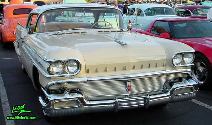 Photo of a beige 1958 Oldsmobile 2 Door Hardtop Coupe at the Scottsdale Pavilions Classic Car Show in Arizona. 58 Olds Eighty Eight Coupe