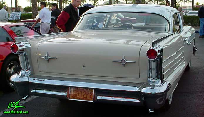 Photo of a beige 1958 Oldsmobile 2 Door Hardtop Coupe at the Scottsdale Pavilions Classic Car Show in Arizona. 1958 Oldsmobile Fins