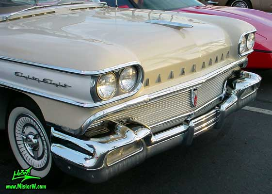 Photo of a beige 1958 Oldsmobile 2 Door Hardtop Coupe at the Scottsdale Pavilions Classic Car Show in Arizona. 1958 Oldsmobile Front Bumper & Chrome Grill