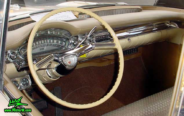 Photo of a beige 1958 Oldsmobile 2 Door Hardtop Coupe at the Scottsdale Pavilions Classic Car Show in Arizona. 1958 Oldsmobile Dashboard & Odometer