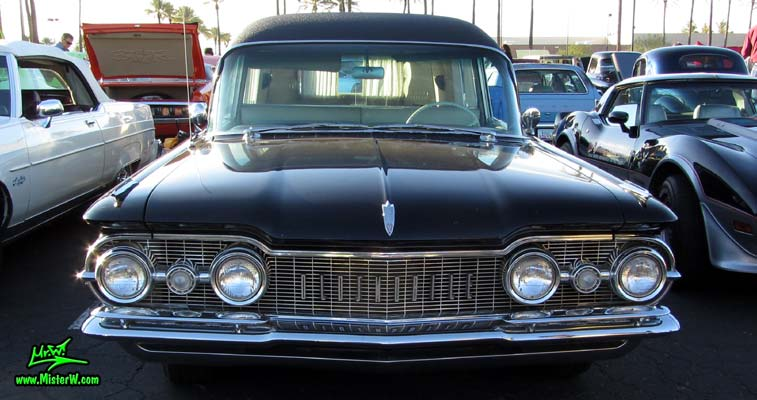 Photo of a black 1959 Oldsmobile Hearse at the Scottsdale Pavilions Classic Car Show in Arizona. Frontview of a 1959 Oldsmobile Hearse