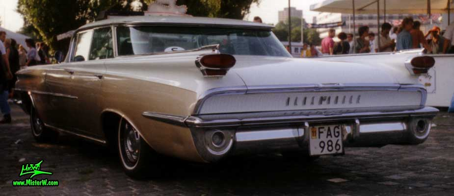 Photo of a white & brown 1959 Oldsmobile 4 Door Hardtop Sedan at a Classic Car Meeting in Germany. 59 Olds Tail Lights & Fins