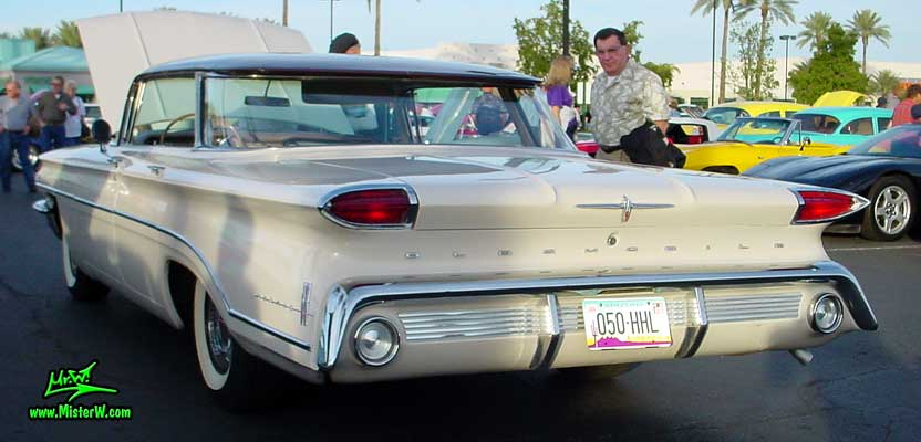 Photo of a white 1960 Oldsmobile 4 Door Hardtop Sedan at the Scottsdale Pavilions Classic Car Show in Arizona. 1960 Oldsmobile Tail Lights & Fins