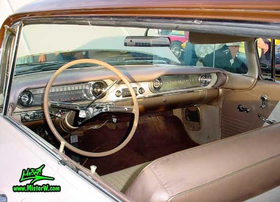 Photo of a white 1960 Oldsmobile 4 Door Hardtop Sedan at the Scottsdale Pavilions Classic Car Show in Arizona. 1960 Oldsmobile Odometer & Dash Board