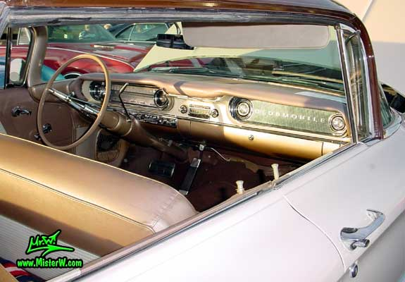 Photo of a white 1960 Oldsmobile 4 Door Hardtop Sedan at the Scottsdale Pavilions Classic Car Show in Arizona. 1960 Oldsmobile Dashboard & Interior