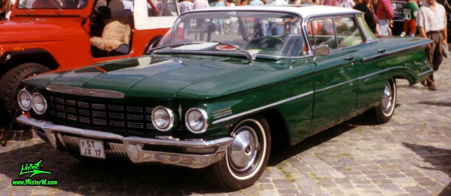 Photo of a green 1960 Oldsmobile 4 Door Hardtop Sedan at a Classic Car Meeting in Germany. 60 Olds Sedan