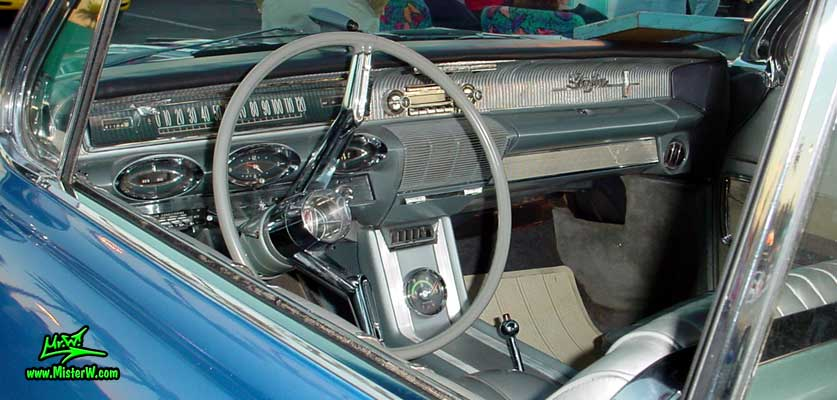 Photo of a blue metallic 1961 Oldsmobile Starfire 2 Door Convertible at the Scottsdale Pavilions Classic Car Show in Arizona. 1961 Oldsmobile Odometer