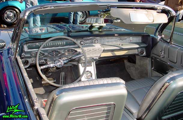 Photo of a blue metallic 1961 Oldsmobile Starfire 2 Door Convertible at the Scottsdale Pavilions Classic Car Show in Arizona. 1961 Oldsmobile Dashboard
