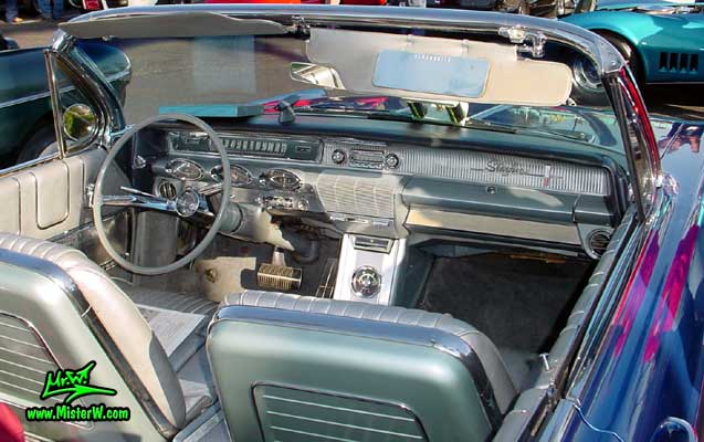 Photo of a blue metallic 1961 Oldsmobile Starfire 2 Door Convertible at the Scottsdale Pavilions Classic Car Show in Arizona. 1961 Oldsmobile Dash Board & Front Seats