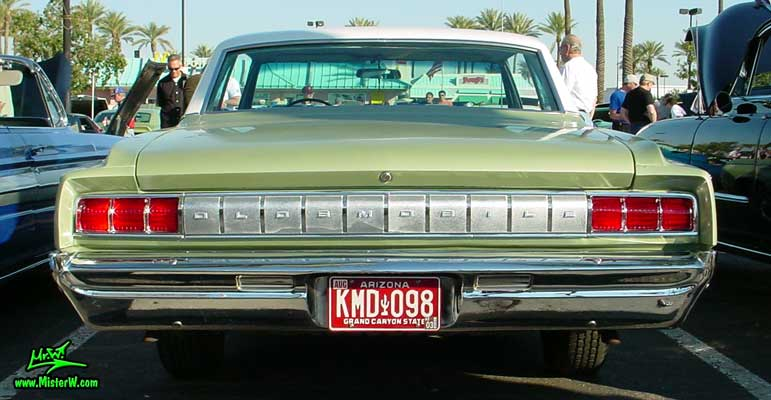 Photo of a olive 1964 Oldsmobile 2 Door Hardtop Coupe at the Scottsdale Pavilions Classic Car Show in Arizona. 1964 Oldsmobile Rearview