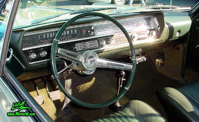 Photo of a olive 1964 Oldsmobile 2 Door Hardtop Coupe at the Scottsdale Pavilions Classic Car Show in Arizona. 1964 Oldsmobile Odometer & Dash Board