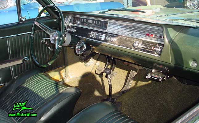 Photo of a olive 1964 Oldsmobile 2 Door Hardtop Coupe at the Scottsdale Pavilions Classic Car Show in Arizona. 1964 Oldsmobile Dashboard & Interior