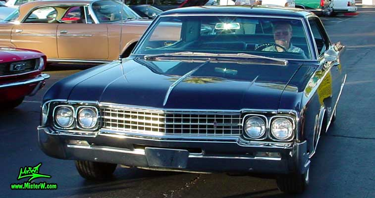 Photo of a dark blue 1966 Oldsmobile Ninety Eight 2 Door Hardtop Coupe at the Scottsdale Pavilions Classic Car Show in Arizona. 66 Olds Coupe