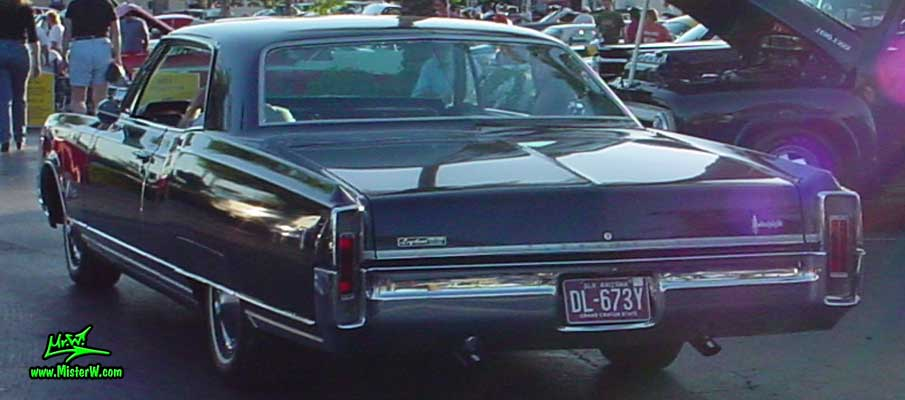 Photo of a dark blue 1966 Oldsmobile Ninety Eight 2 Door Hardtop Coupe at the Scottsdale Pavilions Classic Car Show in Arizona. 1966 Olds Ninety Eight Coupe Rearview