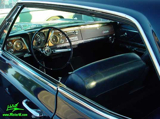 Photo of a dark blue 1966 Oldsmobile Ninety Eight 2 Door Hardtop Coupe at the Scottsdale Pavilions Classic Car Show in Arizona. 1966 Oldsmobile Dashboard & Interior